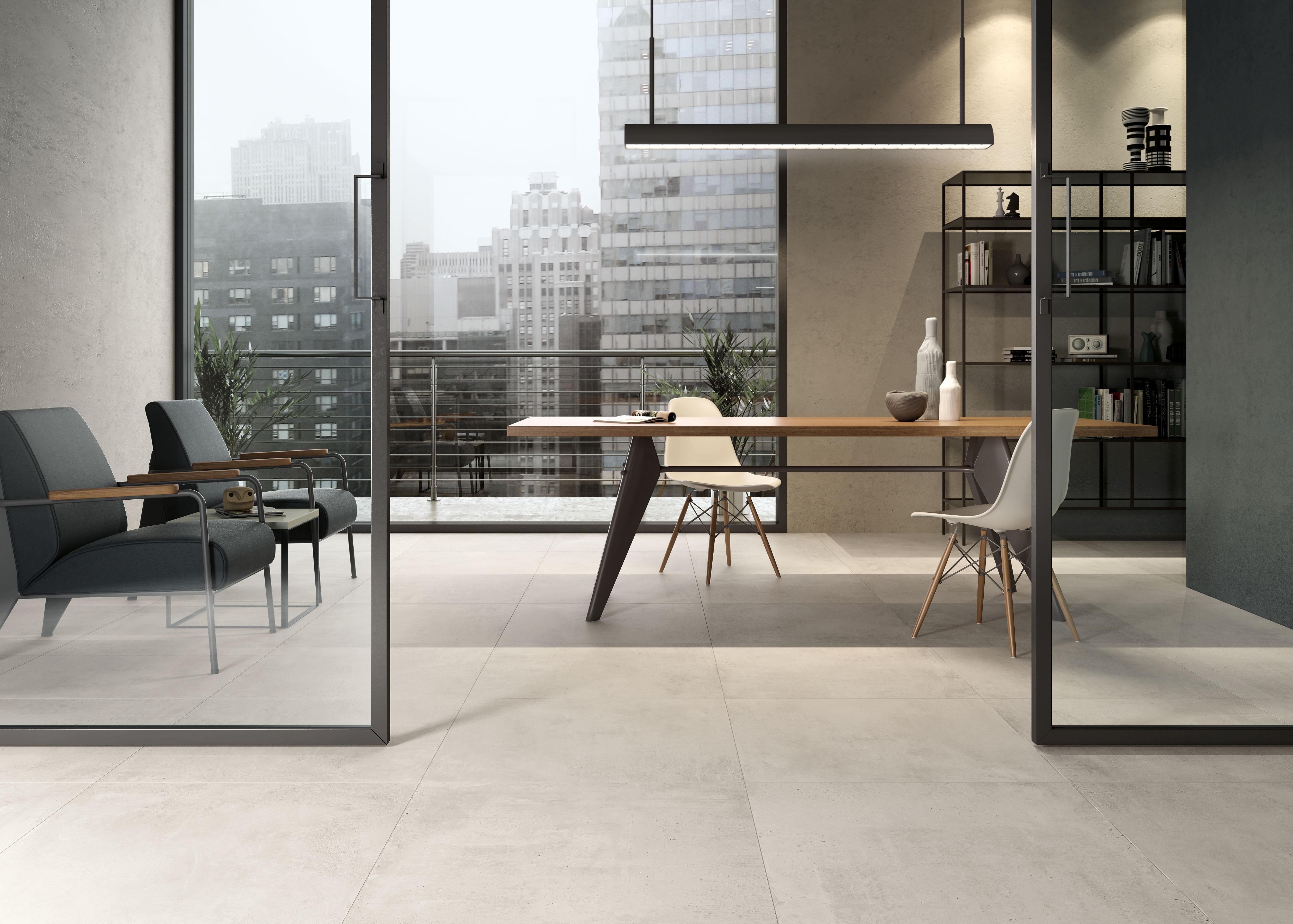 Weiße Betonfliesen im Büro, white concrete effect tiles for the office